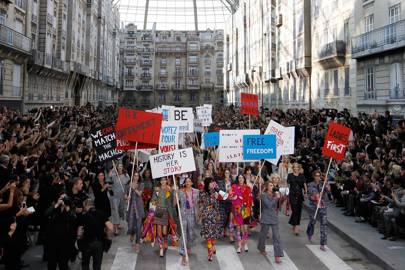 Cara Delevingne takes to the Chanel catwalk for a street protest