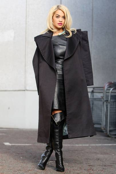 c38cea3b0f0 Going hell for leather: we spotted Rita in a shift, boots and that luxe  black trench as she headed out of the studio and on to her next appointment.