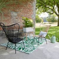 Palm print outdoor rug