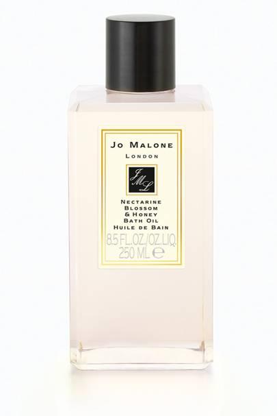 Jo Malone Bath Oil in Nectarine Blossom Honey, £38 for 250ml