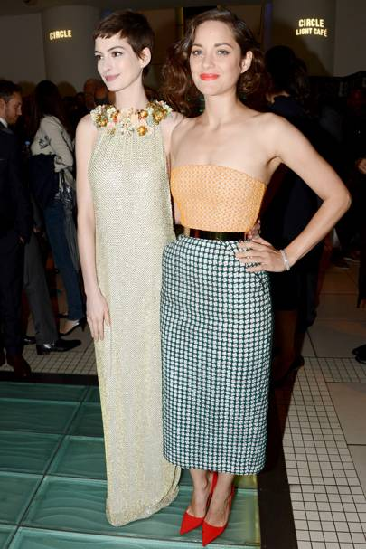 Anne Hathaway and Marion Cotillard at The Dark Knight Rises premiere