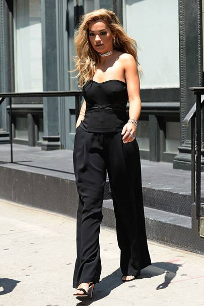 0ca6750f67c Rita showed us how to make a black jumpsuit work for the summer heat while  out in the city.