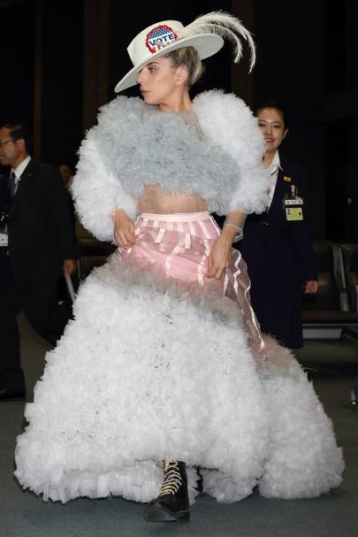 Lady Gaga Stepped Out In Tokyo Ahead Of The Us Elections Wearing A Crazy Tulle Dress With Layers And Ruffles Singer Added Large Badge