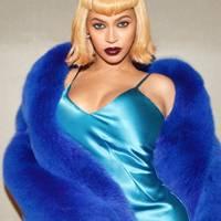 Beyoncé as Lil Kim