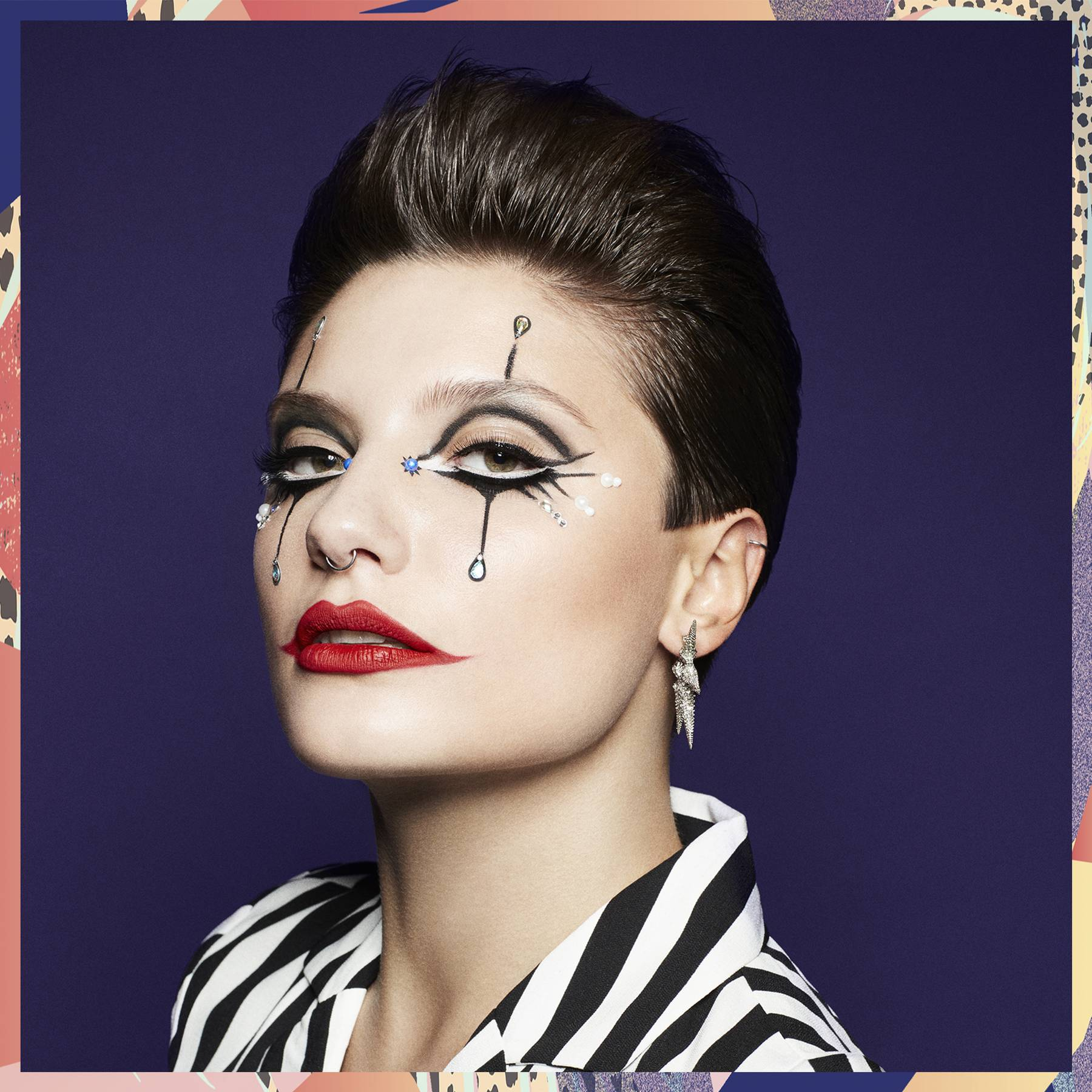 Terrified of clowns? You won't be after you see this chic take on jester-inspired Halloween makeup