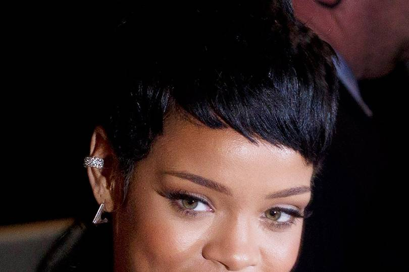 rihanna poses with protected primate in thailand