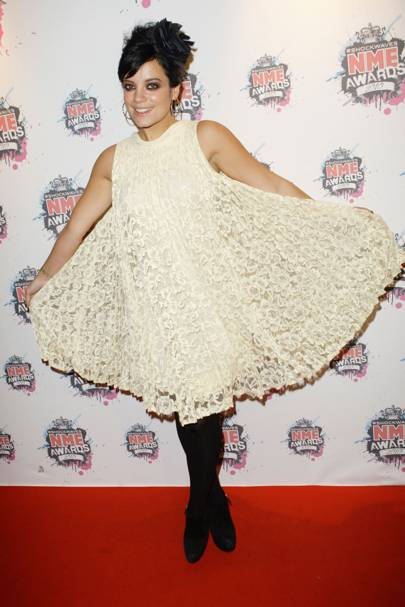 35315d9fc9 Vintage lace and a babydoll cut gave Lily a girly edge as she rocked up to  the 2010 NME Awards sporting an ultra-pretty up-do and chic suede heels.