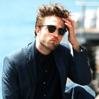 Robert Pattinson poses at Australian photocall for Breaking Dawn 2