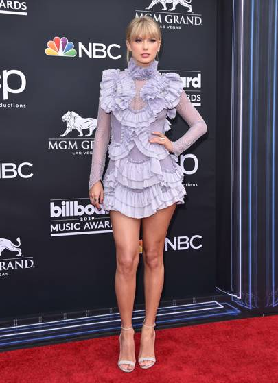 Taylor Swift in a ruffled lilac mini dress