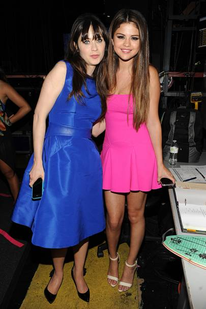 Zooey Deschanel and Selena Gomez at the Teen Choice Awards 2012