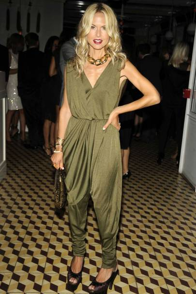 beb79ba29b96 Infamous fashionista Rachel Zoe looks super chic in this shimmering green  romper with gold-accented accessories and killer heels.