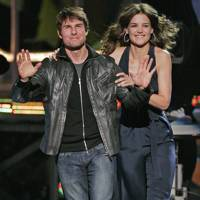 Tom Cruise and Katie Holmes cuddle up