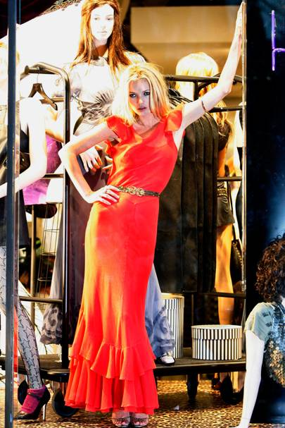 1d82f7e1cab1a The Dress: A red, tiered-hem maxi dress from her inaugural Kate Moss For  Topshop collection. The Occasion: A sensational shop window appearance to  launch ...