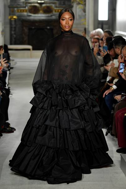 Naomi Campbell in sheer black on the Valentino Haute Couture runway