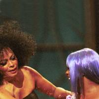13. Diana Ross cops a feel of Lil' Kim