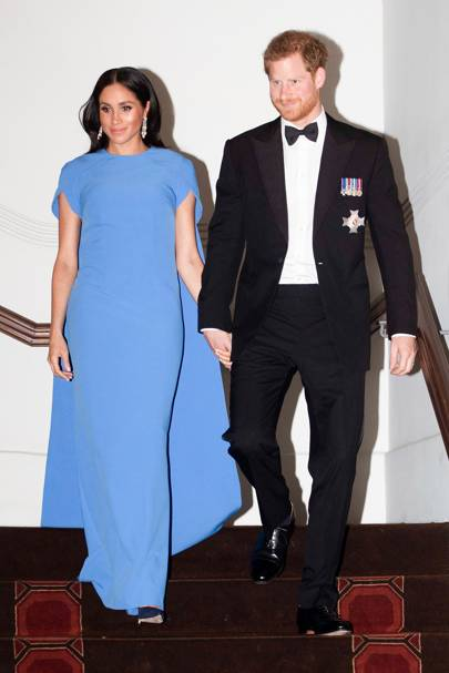 eae4334a2fc4c Meghan shows off her pregnancy glow in a striking blue Safiyaa gown at a  state dinner in Fiji and we'd argue its her best look yet.