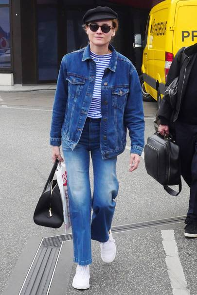 f9dba4d63c ... put a foot wrong by matching her double denim with this incredible red  boots. Gimme. Getty Images. Diane Kruger gives us lessons on how to make  double ...