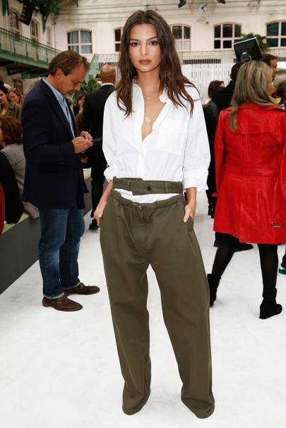 ba44dda4929 Where  Valentino Wearing  The actress and model pulled off extra long khaki  trousers with a crisp white shirt.