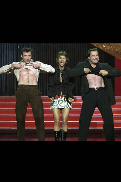 John Travolta and Hugh Jackman compare six packs