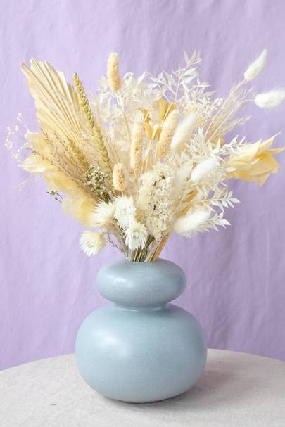 Dried palms, bunny tails, strawflowers and broom bloom