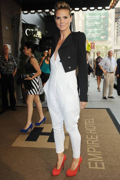eebedea544c6 How chic does Heidi Klum look in this low-cut white jumpsuit and cropped  black jacket – both from Givenchy s Spring 2010 collection.