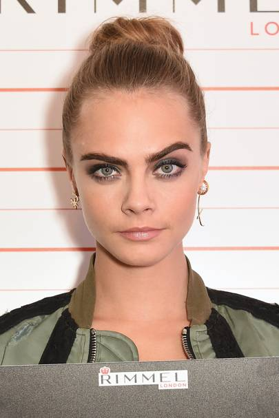 At a Rimmel event, Cara rocked her classic big brows, nude lips and a topknot.