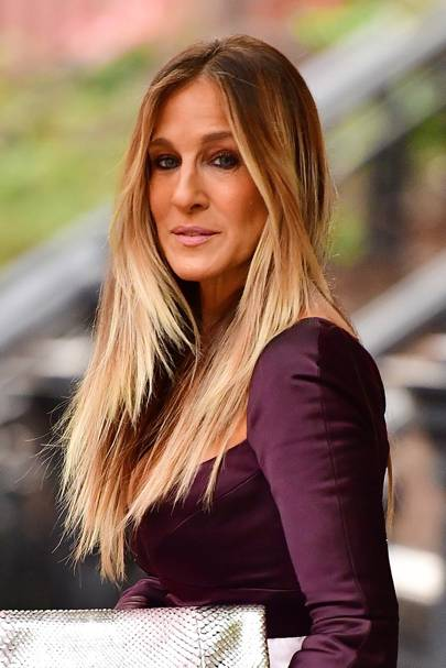 2013: Wow - SJP is currently sporting super long straight locks - a look we haven't seen from her in a while! She's kept the ombre effect, however.