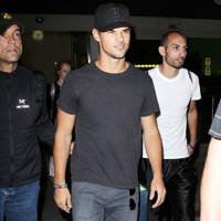 Taylor Lautner arrives at LAX airport in Los Angeles