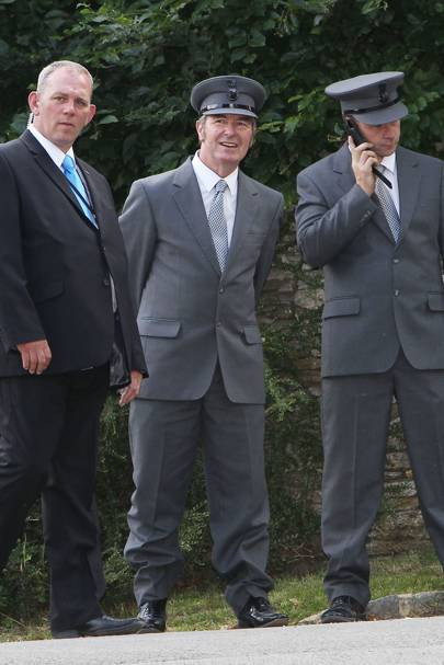 The wedding chauffeurs wait for Moss and Hince to leave the church