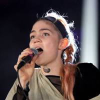 Grimes performs at Reading Festival 2012