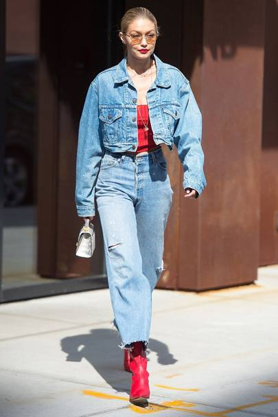 66b93d3f96 Supermodel Gigi Hadid doesn t put a foot wrong by matching her double denim  with this incredible red boots. Gimme.