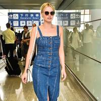 8be3acde0c291 Bang on trend with red checks, Dakota Johnson strolls through JFK Airport  with an air of chic effortlessness that we could only dream of in an  airport.
