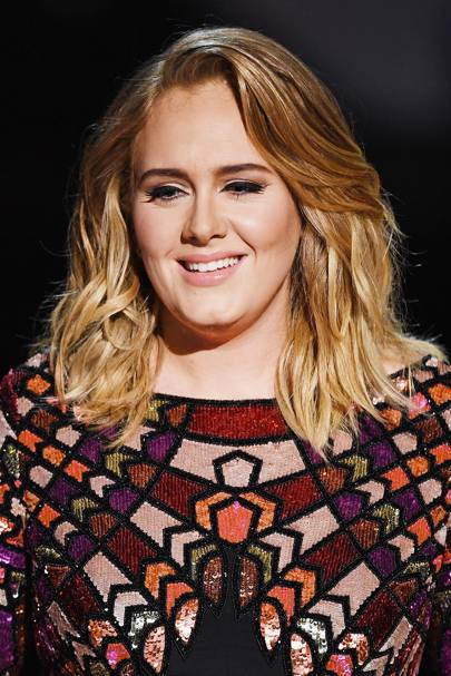 For Adele's opening performance at the GRAMMY Awards, Chris used a large barrel curling iron and hit it with the hair dryer to give it shine for the stage.