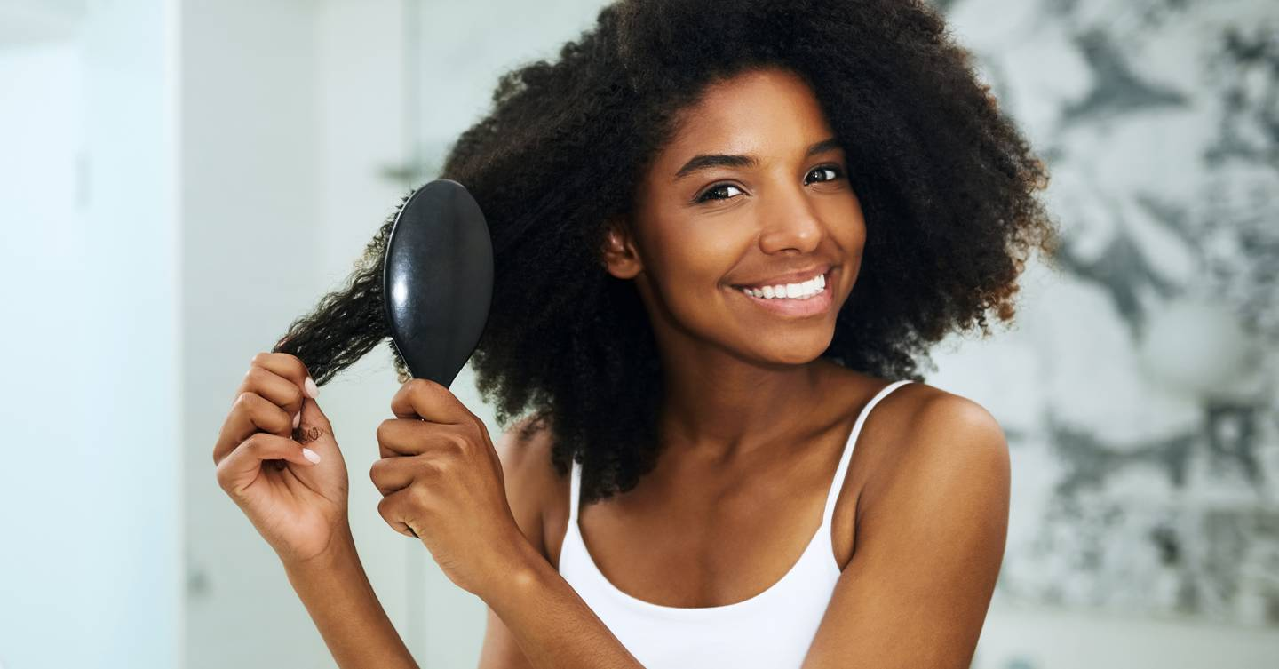 How to treat dandruff in afro hair, according to a top trichologist