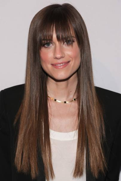 Medium Length Haircut With Curtain Fringe